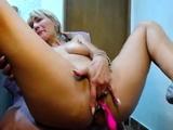 Blonde busty slut toying her fine pussy