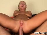 Pretty darling with huge natural tits is fucked from behind