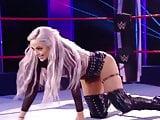 WWE - Liv Morgan posing between the ring ropes
