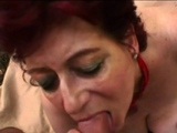 Granny babe is deep throating a big cock
