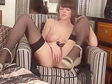 Amateur in high heels busts her tits out and masturbates