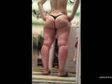 Russian Stepmom with her ass in thong