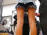 Sexy Saleswoman In Denim Shorts In Store