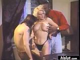 Busty blonde has fun with two long schlongs