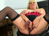 British milf Christina X pleases her fuckable fanny