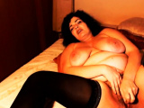 Curvy mature mom in stockings toying hairy pussy