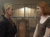 Superb MILF eats her young redhead friend
