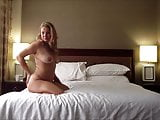 Sexy blonde wife posing naked