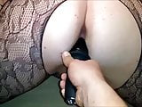 Thick MILF in fishnets fucked hard with a big dildo