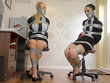 Two whores tied up in ducktape in a bondage video