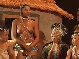 Topless African girl with huge areolas tells some story
