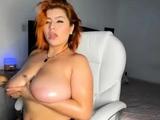 Cute tattooed milf makes solo striptease porn