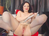 Brunette with a hairy pussy likes wearing nylon stockings on her feet