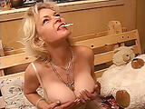 busty mature smoking and masturbates teaser