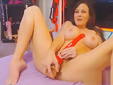 Busty brunette Jenny Coture plays with huge toy